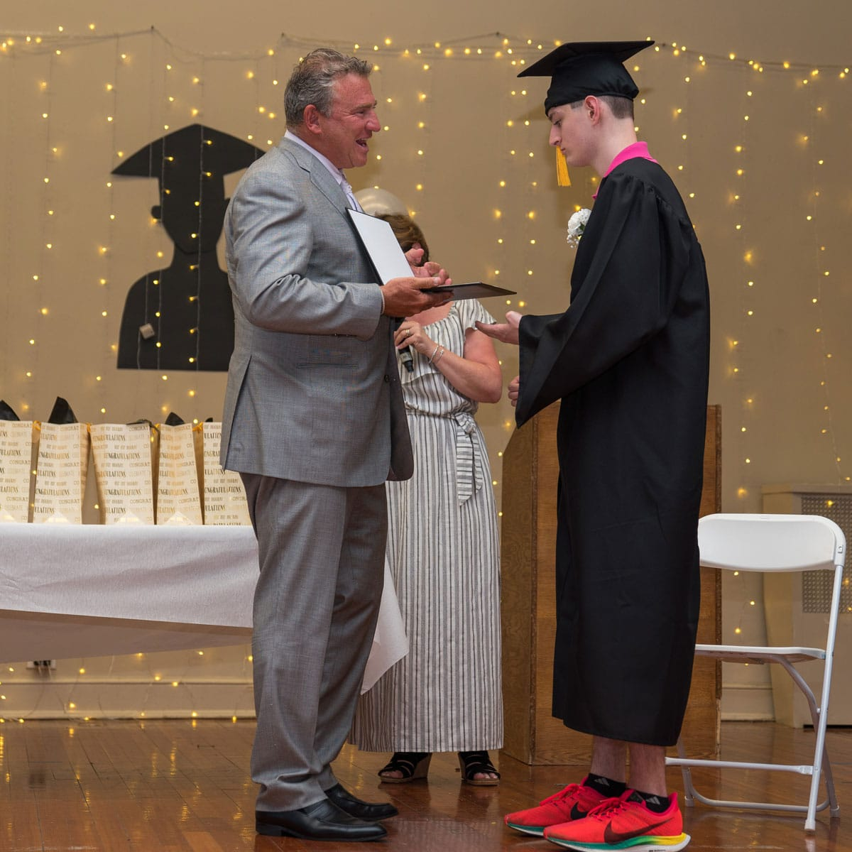 Gersh Academy Student Getting his Diploma From Kevin Gersh