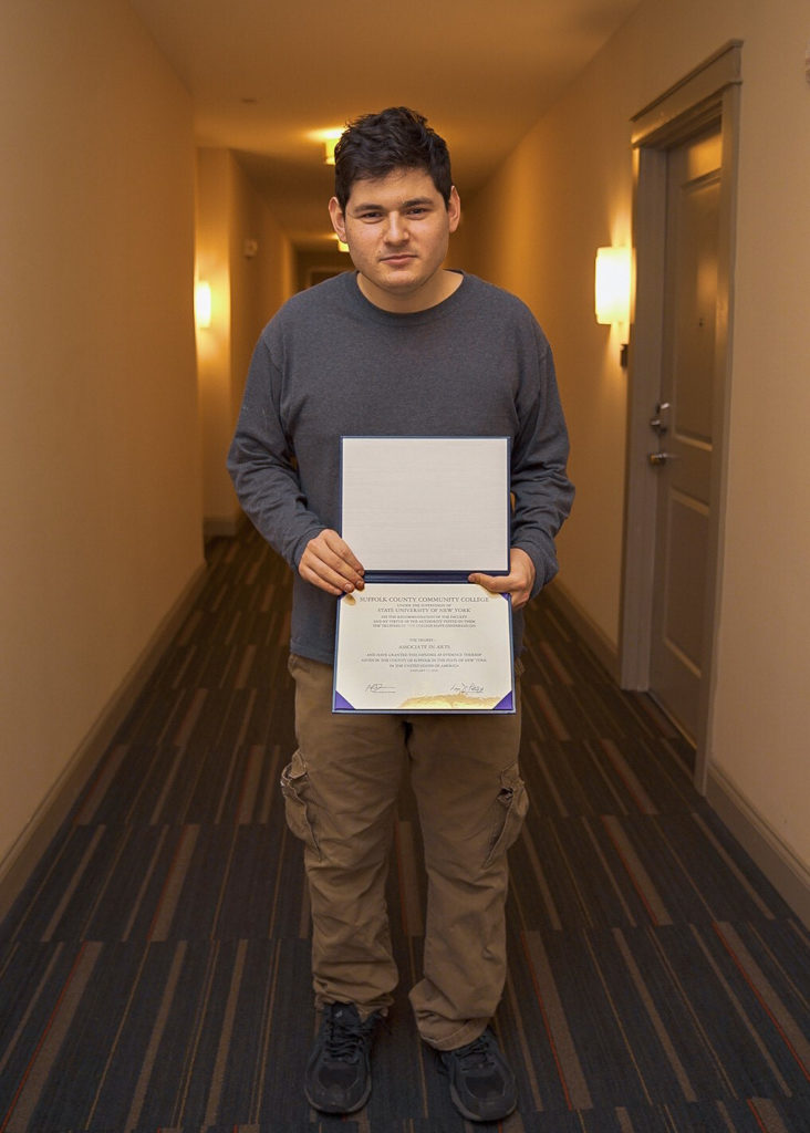 Gersh Experience Student Holding his Diploma