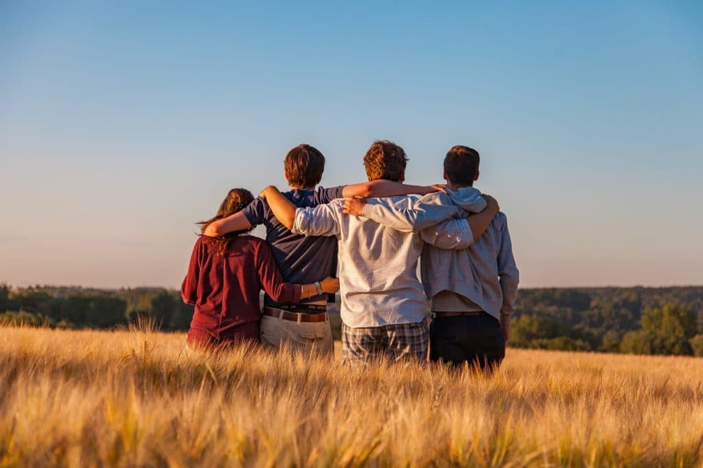 Family Hugging and Looking off Into the Distance
